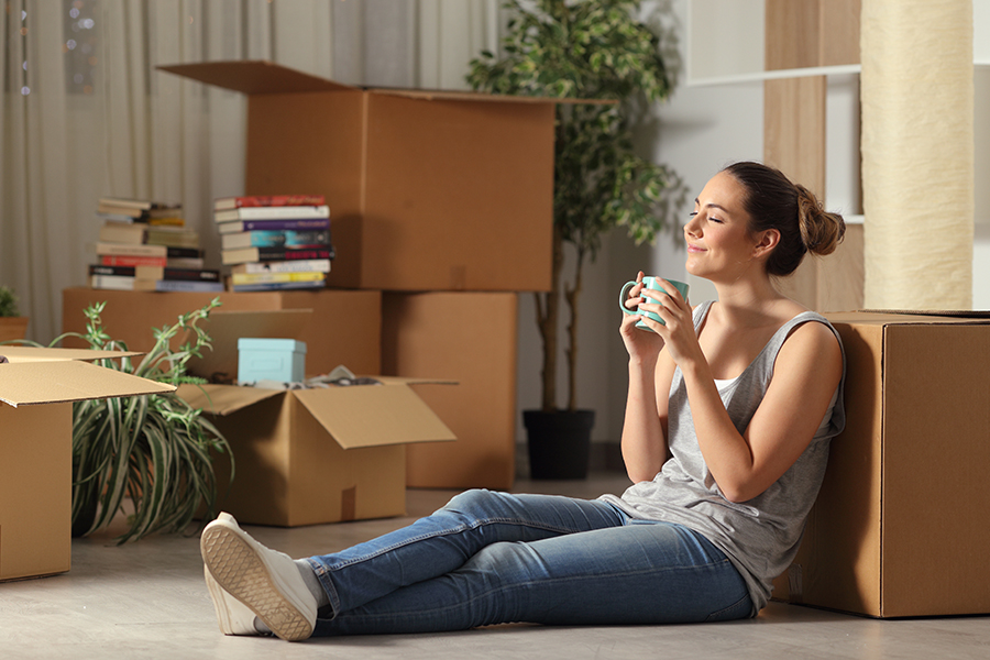 Renters Insurance - Happy Tenant Moving into New Home Resting and Breathing in Fresh Air